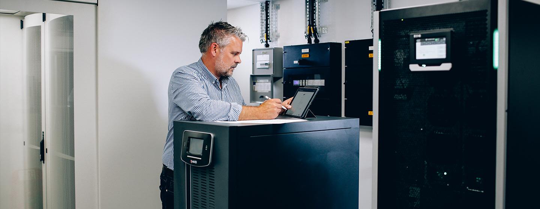 UPS expert surveying server room